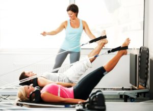 Pilates instructor with clients